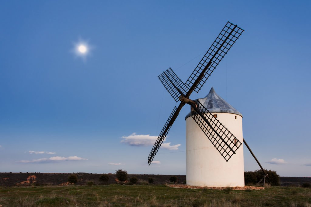 Typical windmill in with the moon at the background
