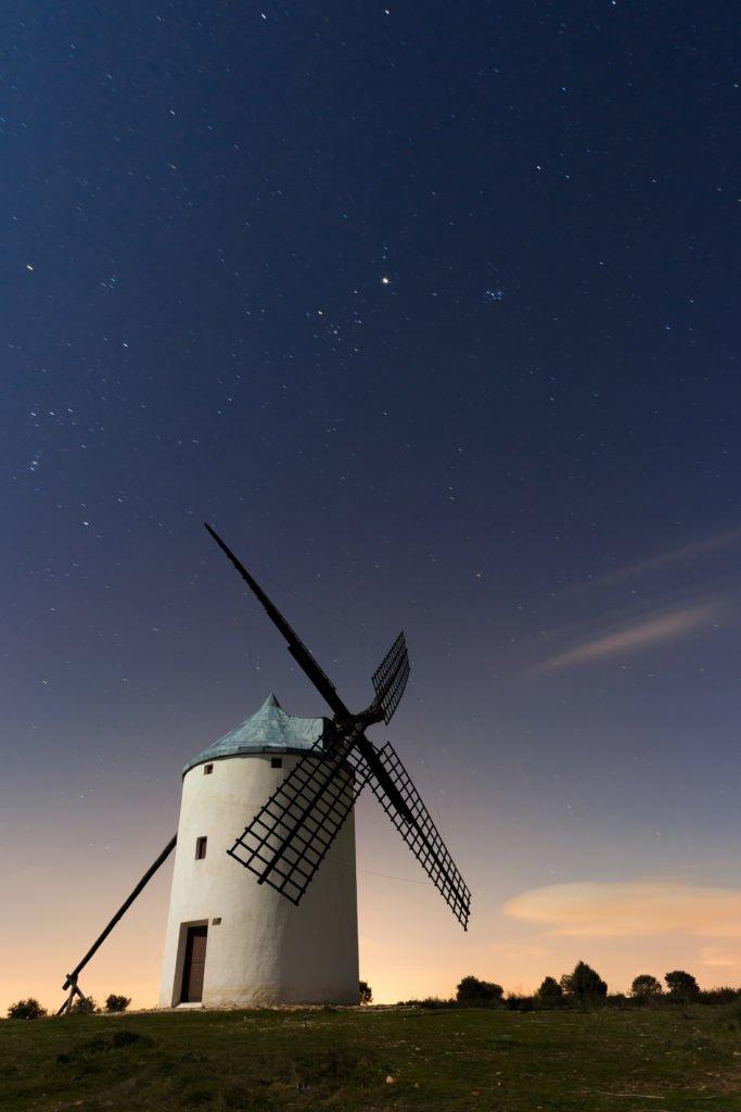 Typical windmill surrounded of stars in Castilla la Mancha, Spai